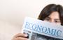 Woman reading economics