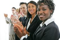 Picture of business men and women clapping