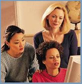 Picture of business women looking at a computer screen